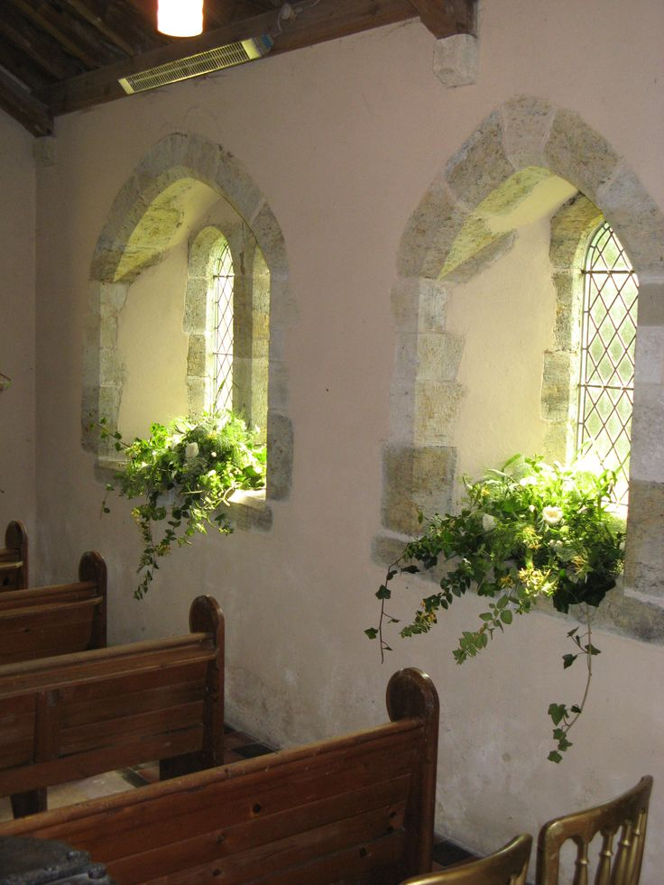 St Mary's Church, Barlavington, windowsills decorated with trailing foliages and scented roses