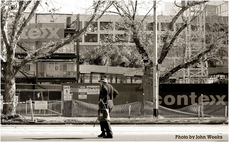 Old man walking past a construction site near St. Kilda Road, Melbourne  on 25 April 2010