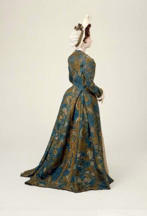 Dress        Italian (Venice), about 1700         Venice, Italy  Dimensions      146.5 cm (57 11/16 in.); Legacy dimension: CB: 57 1/2 in.  Medium or Technique      Silk; bizarre silk: fanciful floral motifs brocaded with polychrome silk threads and lance with gold metallic threads on blue silk damask ground  Classification      Costumes     Accession Number      43.1629  Not on view