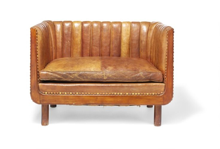 Vilhelm Lauritzen: A unique freestanding 1,5 seater sofa with round legs and frame of stained beech. Upholstered with original patinated Niger leather. A unique freestanding 1,5 seater sofa with round legs and frame of stained beech. Sides, back and loose seat cushion upholstered with original patinated Niger leather, edges fitted with leather covered buttons. Designed and made approx. 1934 by cabinetmaker Jacob Kjær. H. 71 cm. L. 100 cm. D. 66 cm.