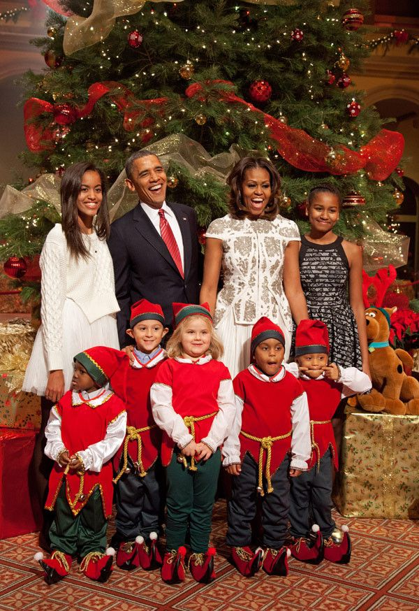 U.S. President Barack Obama, first lady Michelle Obama, and daughters Malia (left) and Sasha pose with 'elves' prior to the taping of TNT's 'Christmas in Washington' on December 15, 2013 in Washington, DC. The program benefits the Children's National Health System. Elves shown (L – R) are Elijah Jaydon Young (4), Rocco Rueda (6), Brook Rosenberg (5), and twins Dale and Delaney Crawford (4). (Photo by Martin H. Simon-Pool/Getty Images)
