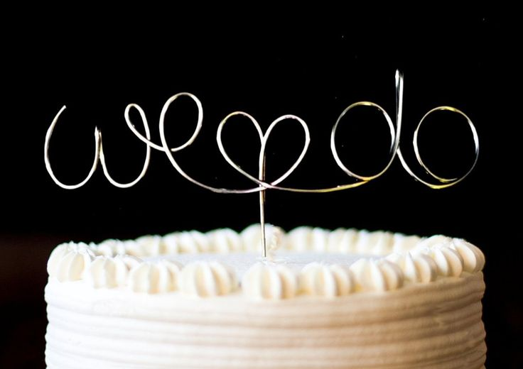 Cake Topper Monogram Silver Set, We Do. $22.99, via Etsy.