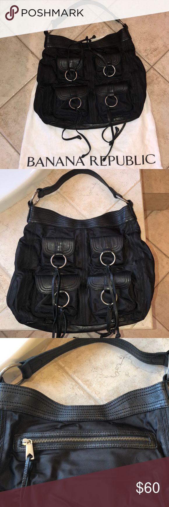 Banana Republic lightly used black hobo handbag Banana Republic black hobo style handbag. An awesome bad leather trim and silver hardware an assortment of pockets Banana Republic Bags Hobos