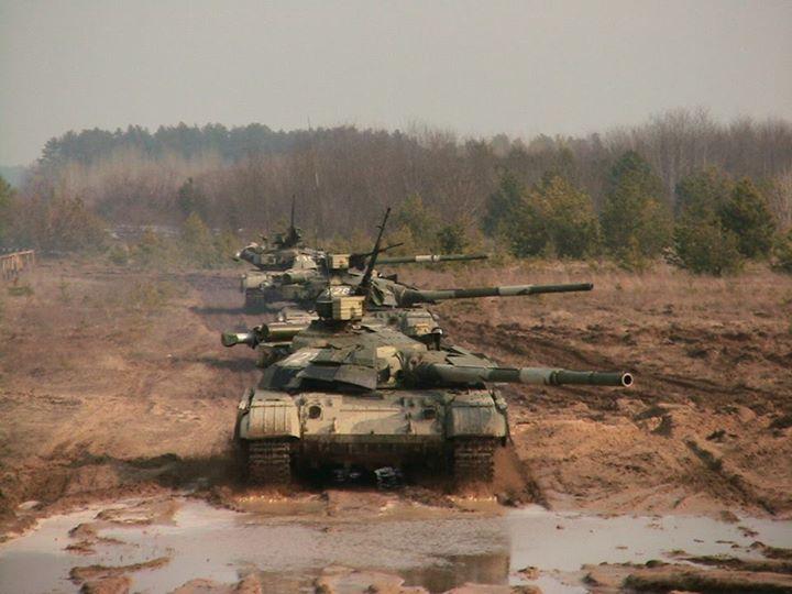 "Ukrainian main battle tanks T-64BM ""Bułat"" during maeuvers"