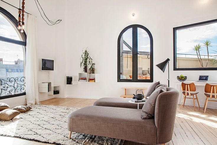 Minimalist modern lounge  with slim frame single piece aluminium black mate window for a  by technal by Ambit Arquitectes in Diagonal Av. Barcelona