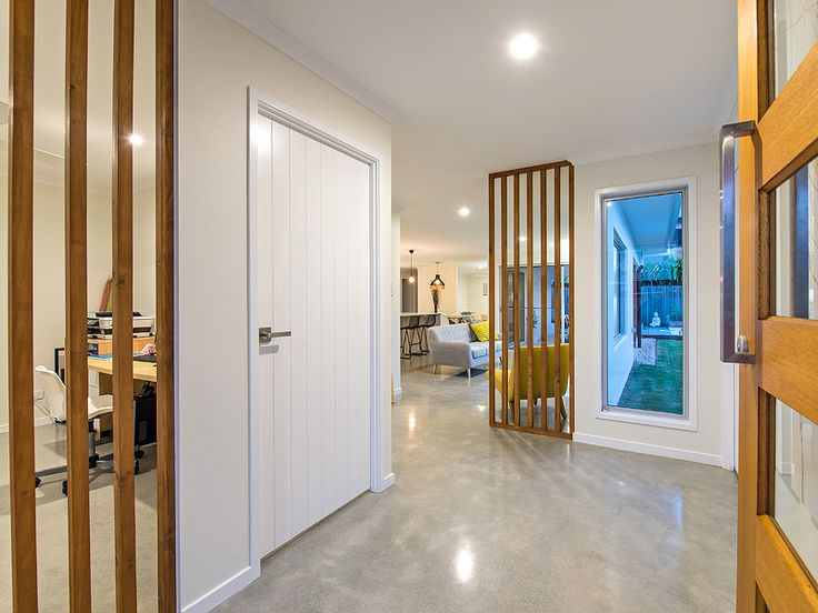 Polished concrete floors- open entry with timber features www.studioldm.com.au
