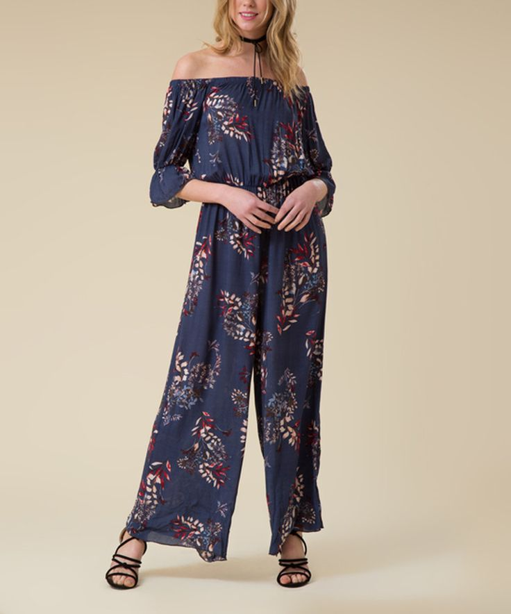 Take a look at this Blue Floral Bandeau Jumpsuit today!