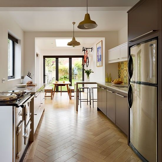 Galley kitchen with parquet flooring | Be inspired by a vibrant retro 1960s family kitchen | housetohome.co.uk