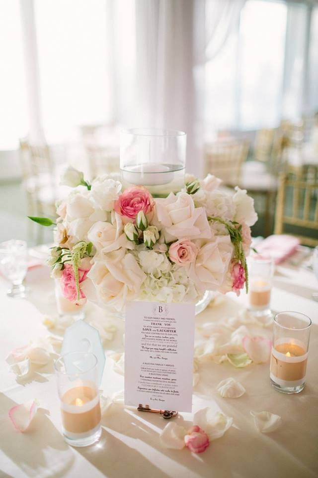 fall in love with the soft romance of this gorgeous floral centerpiece. you can see more breathtaking images from Driver Photo here http://www.weddingchicks.com/vendor-guide/driver-photo/ #driverphoto #romaticflorals #floralcenterpiece