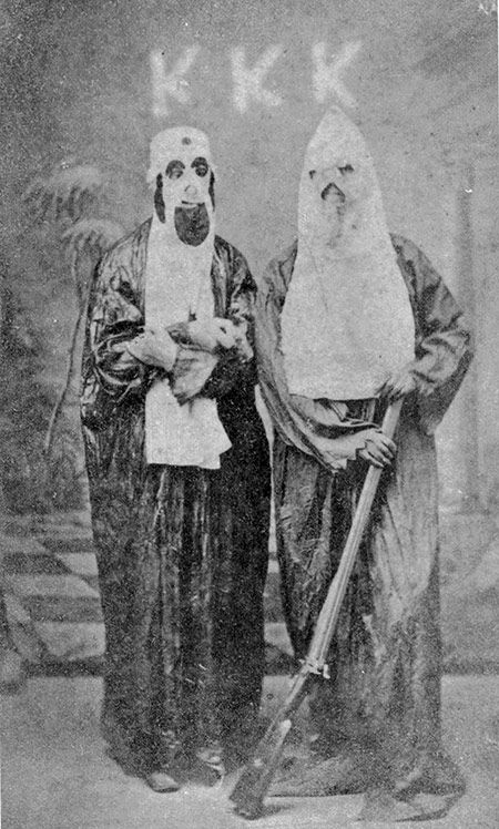 In the hood: two members of the Ku Klux Klan, c.1870. The KKK was founded on 24 Dec 1865.