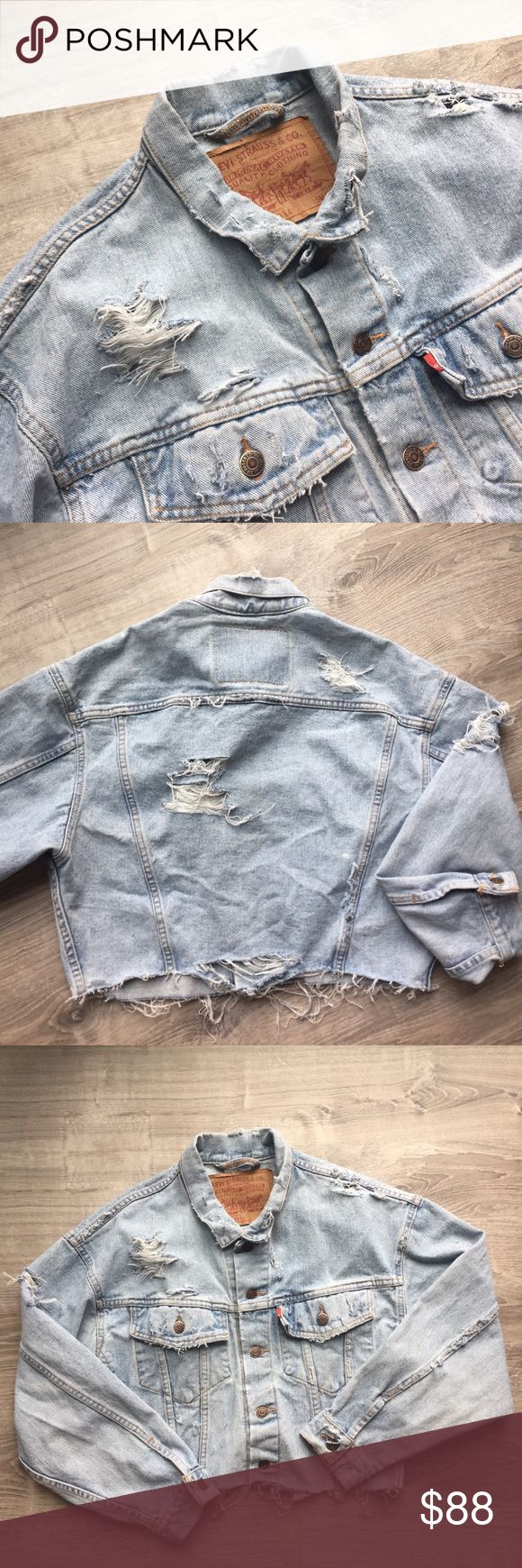 light wash distressed Levi's denim jacket decided to crop & distress this gem myself 🤷‍♀️ love the way it turned out. a men's small, so it's an oversized fit on me Levi's Jackets & Coats Jean Jackets