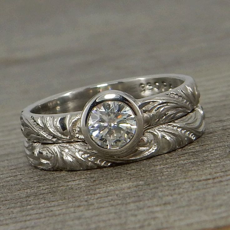 Moissanite and 950 Palladium Engagement Ring and Patterned Wedding Band, Forever One G-H-I, Conflict Free, Eco-Friendly - Made To Order by McFarlandDesigns on Etsy https://www.etsy.com/listing/520587757/moissanite-and-950-palladium-engagement