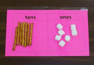 Pretzel sticks for tens and marshmallows for ones. Cute edible activity to teach place value.