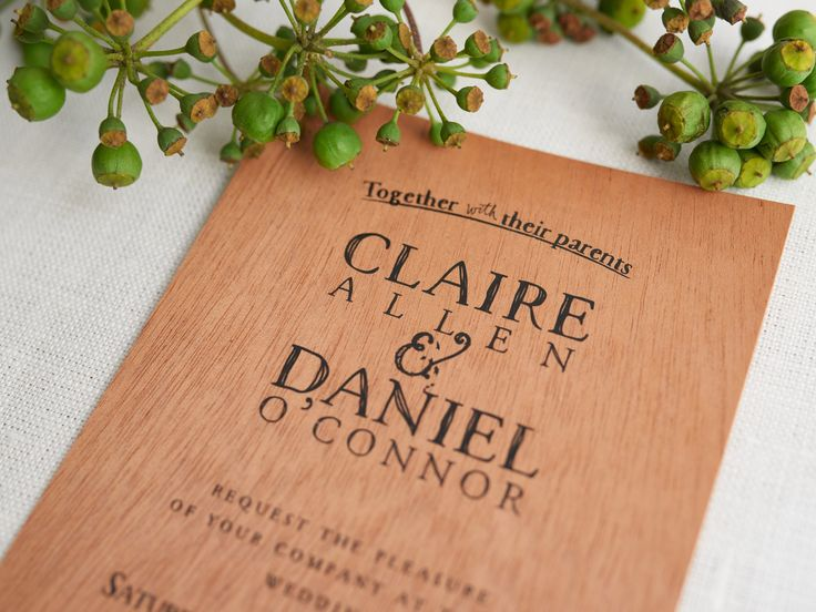 Rustic wedding invitations. Printed on wood.