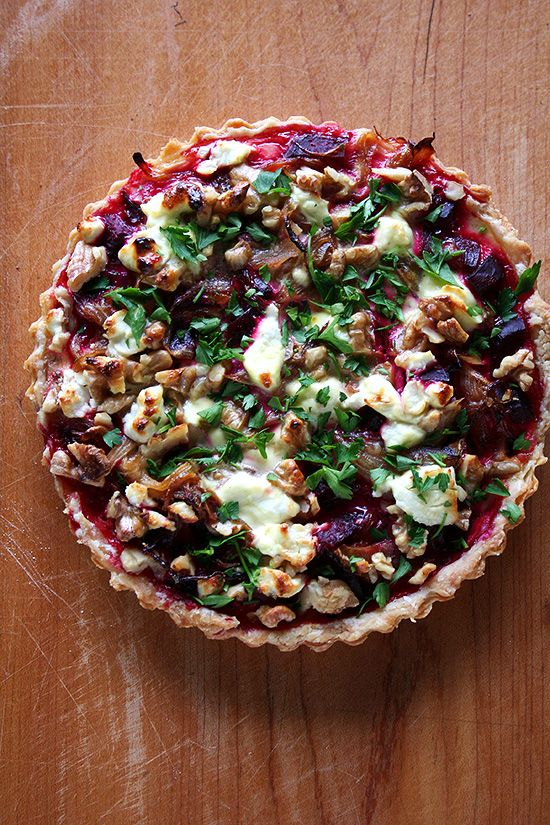 This goat cheese walnut tart is really fun. And different. And delicious. I can't promise a quick-and-easy dinner with this recipe — beets must be roasted; a tart shell must be baked — but with a little planning, assembly of this tart is quite simple. And it is so worth the effort.
