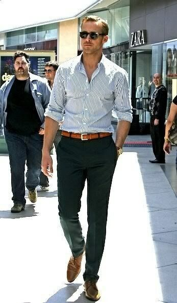 Mens street style fashion: ryan gosling business casual outfit navy green pants, brown leather belt oxford shoes, blue white striped shirt