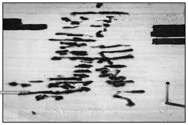 Black and white abstract realism photography print for sale—A roofing repair work looks like abstract handwriting with a graffiti look. Black and white abstract photography for art collectors or for a contemporary or eclectic wall decor.