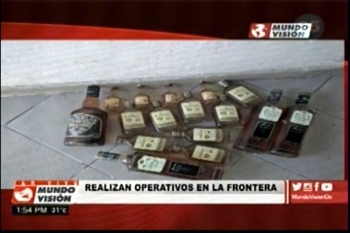 Autoridades fronterizas diariamente capturan cantidad bebidas y todo tipo de armas que entran de contrabando desde Haití