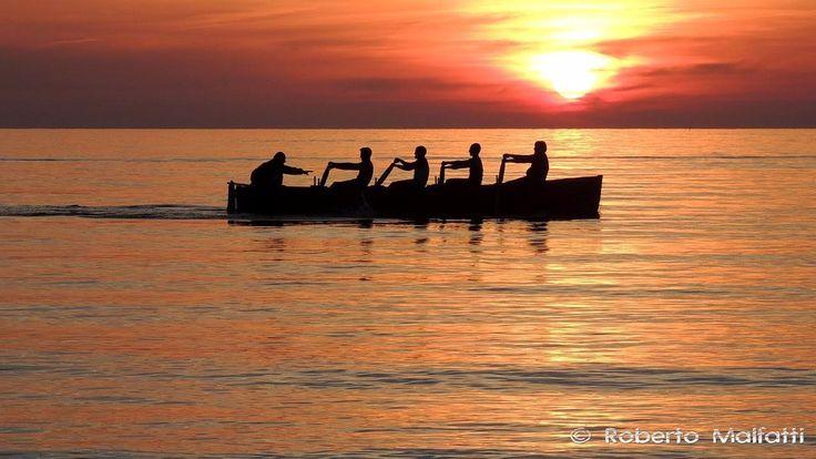 Rowboat at sunset 1713