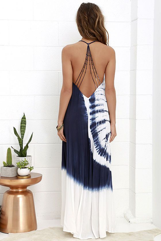 You'll blend right in with your tropical surroundings as you stroll along your vacation vessel in the Caribbean Cruise Ivory and Navy Blue Tie-Dye Maxi Dress! Lightweight rayon, in a unique tie-dye print, flows from a braided T-strap into beaded back straps, a triangle bodice, and flowy maxi skirt.