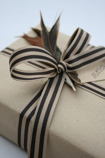 Simple kraft wrap with striped ribbon and feathers! http://www.nashvillewraps.com/wholesale-ribbon/showpage.ww?page=wholesaleribbon