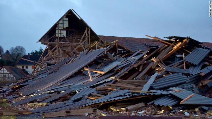 Powerful storm wreaks havoc across western Europe - An agricultural building  collapsed during a heavy storm in Meimbressen, central Germany, on Thursday.