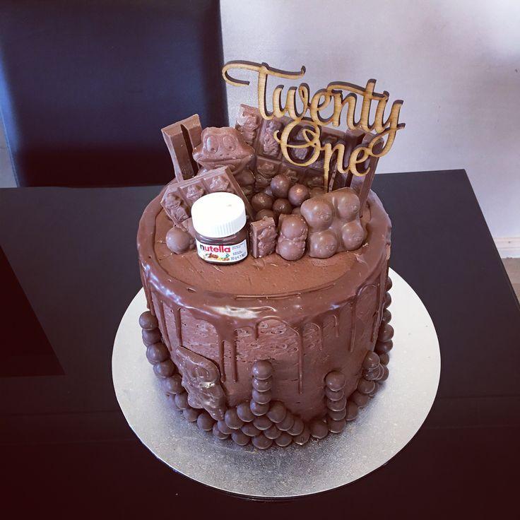Chocolate drip cake with loads of extras for a twenty first. 21st. Twenty one