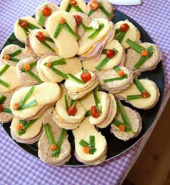 """How """"flippin"""" cute is this!? All you need is a flip flop cookie cutter, green pepper, red pepper, cherry tomatoes, carrots and any other veggies you can imagine. Get creative!"""