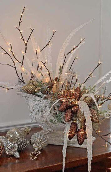 winter decor. sleigh filled with lighted twigs, pinecones, feathers,  ornaments