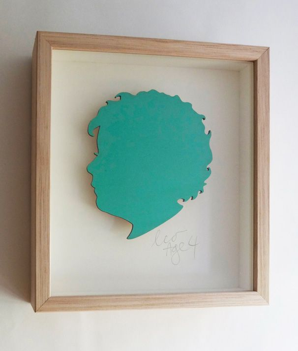 Leo. 3mm plywood silhouette painted in Cuban Turquoise, cream mount. Name/age hand written in pencil. Oak frame. 250mm high x 230mm wide x 50mm deep.