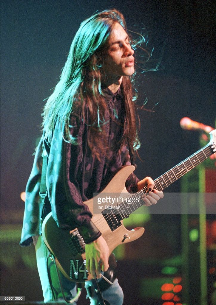 Nuno ❤️Bettencourt of Extreme performing on stage at Wembley Stadium, London 18 July 1992.