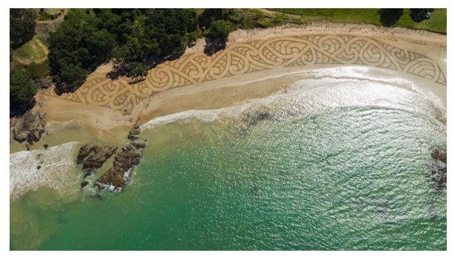 'Piapia Beach' artwork. A collaboration between Andres Amador with Māori ta moko (traditional Māori) tattoo artist Lloyd James Morgan who supplied the design. Photo Credit: Andres Amador/Jonathan Clark Studio via drone technology.
