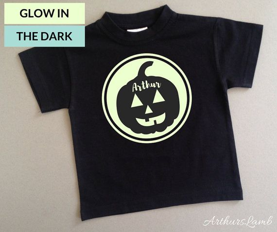 This personalised Pumpkin Logo Graphic is great to wear all fall, but especially cute for Halloween!! And with the Glow in the Dark design, this t-shirt will be perfect for a first Halloween costume or a Halloween gift.  When ordering, please note the name required in Comments to Seller box during checkout.  I only use t-shirts made from 100% cotton fabric. I personally customised the design and apply all the designs to ensure a high quality product. This t-shirt is produced on a black…