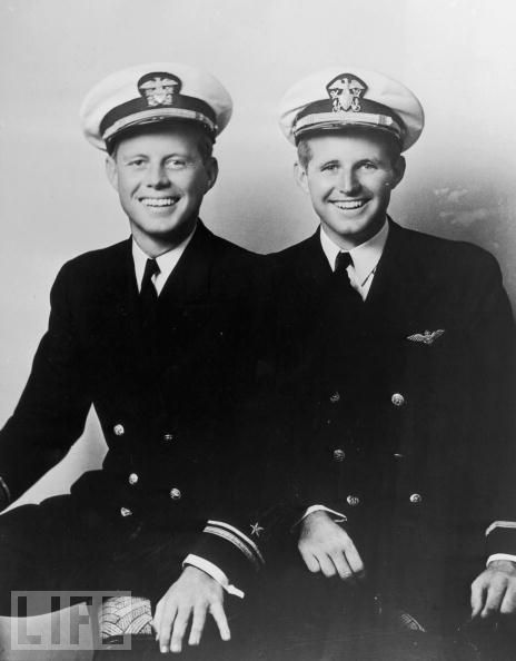 Both John and his older brother Joseph (right) joined the Navy — John had back problems and needed to use family connections and appeal to the Director of the Office of Naval Intelligence in order to enlist — but otherwise their experiences could hardly be more dissimilar. John eventually served on an 80-foot, 56-ton torpedo boat in the Pacific, while Joseph became an aviator based in Britain. Above: The two brothers in their naval uniforms, circa 1942