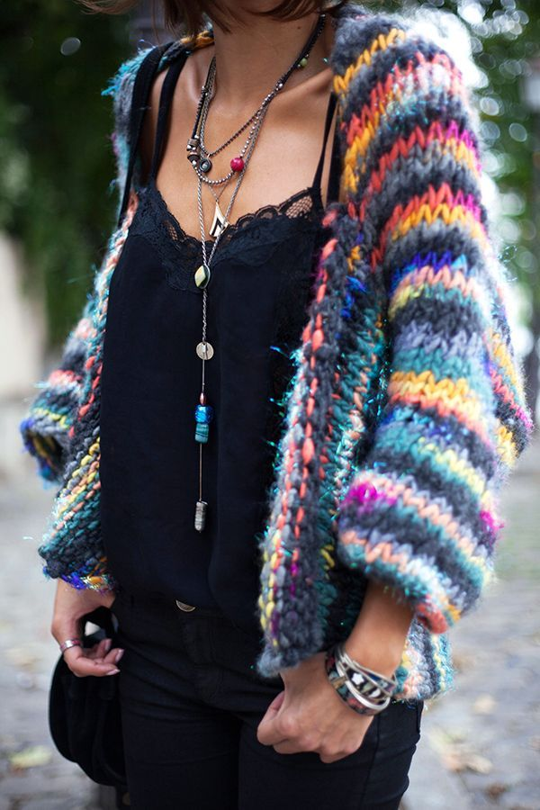 The giant colorful sweater might not be considered chic, but it's definitely unique! ~bS