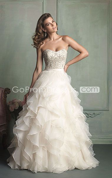 In love! Not too much bling or poof fitted upper body. Strapless. #weddingdress