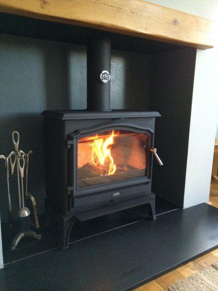 Esse 100, honed granite hearth, oak fireplace beam.jpg
