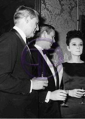 Audrey Hepburn photographed with Cary Grant at a cocktail party held at Le Meurice Hotel in Paris (France)