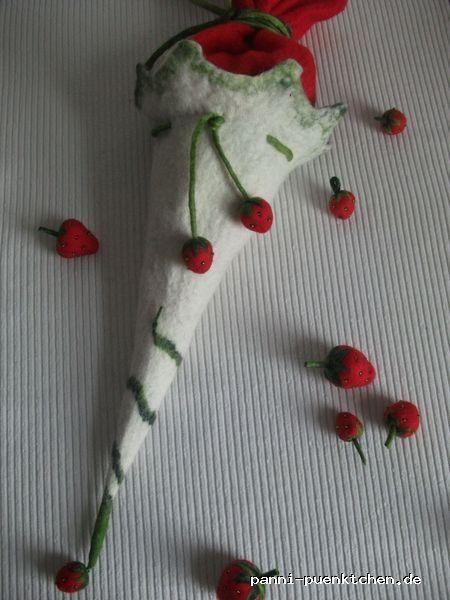 """Schultüte """"Süßes Früchtchen"""" mit Überraschung...  """"Beerige"""" Schultüte mit süßen Erdbeeren aus Filz. Die Schultüte ist liebevoll handgefilzt, außen mit gefilzten Erdbeeren verziert - *und innen mit süßen Zuckererdbeeren gefüllt!* Als Überaschung für´s Schulkind packe ich noch ein kleines *""""erdbeeriges"""" Geschenk* in die Tüte   Tags: #Filz, #handgefilzt, #Schulanfang, #Erdbeeren, #Filzerdbeeren  Preis pro Artikel: 39.00 € zzgl. Versandkosten"""