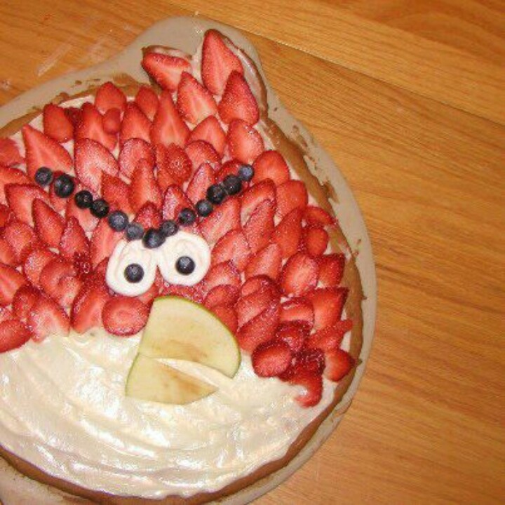 Angry birds fruit pizza - straberries, cream cheese, apples, blue berries. could also cover white portion with banana slices.