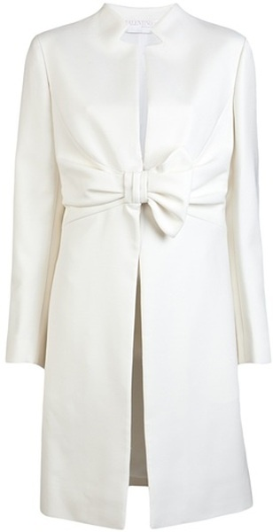 Valentino White Bow Waist Coat.   This wool-blend coat features an asymmetric collar, buttoned bow closure on the waist, long sleeves and full lining.