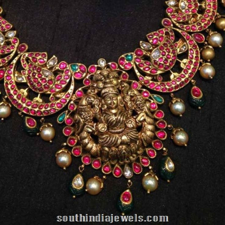 Traditional gold ruby temple necklace from NAJ Jewellery. The necklace is studded with rubies. emeralds, polki stones and south sea pearls.