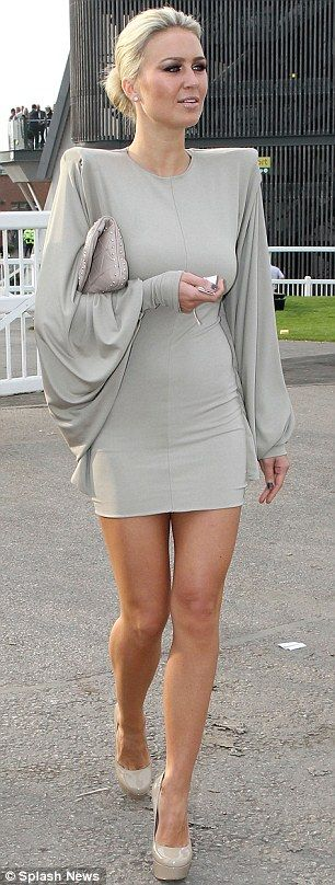 Daring: Alex Curran looked stunning in a short minidress with pointed shoulders at Aintree