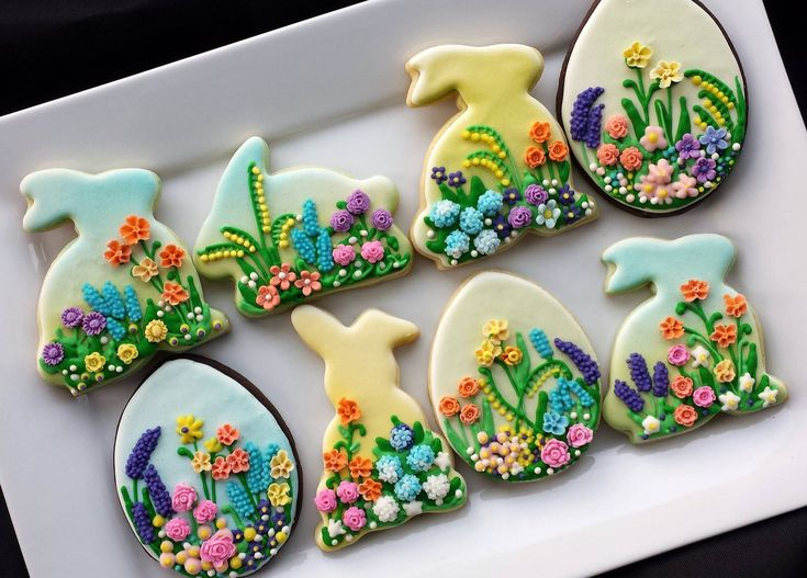 Beautifully decorated Easter bunny and eggs cookies. Spring flowers.