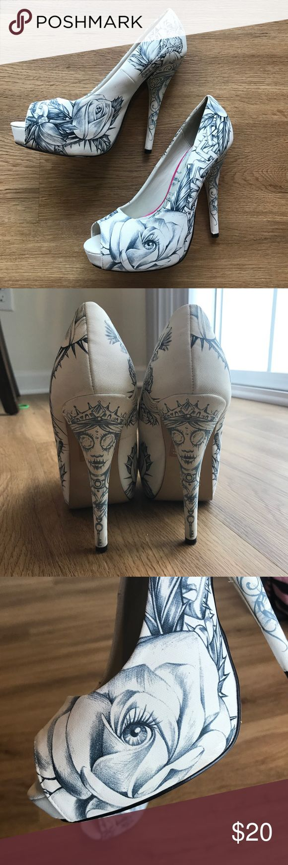 "Iron Fist Pumps super rad, tattoo like sketch design, iron fist pumps. never worn outside, only inside when trying on clothes. porcelain white with blue based grey sketches of roses, chains, keys eye, and a face. tall heel with about 1"" platform at toe. US 10, says EUR 41, but they are definitely a 40, or they just run really small. super special to me, if you're are genuinely interested, comment an offer and i will reply Iron Fist Shoes Heels"