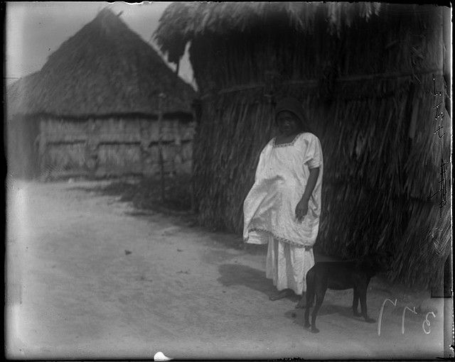 Woman and dog on road by The Field Museum Library on Flickr. 1899, centroamérica.