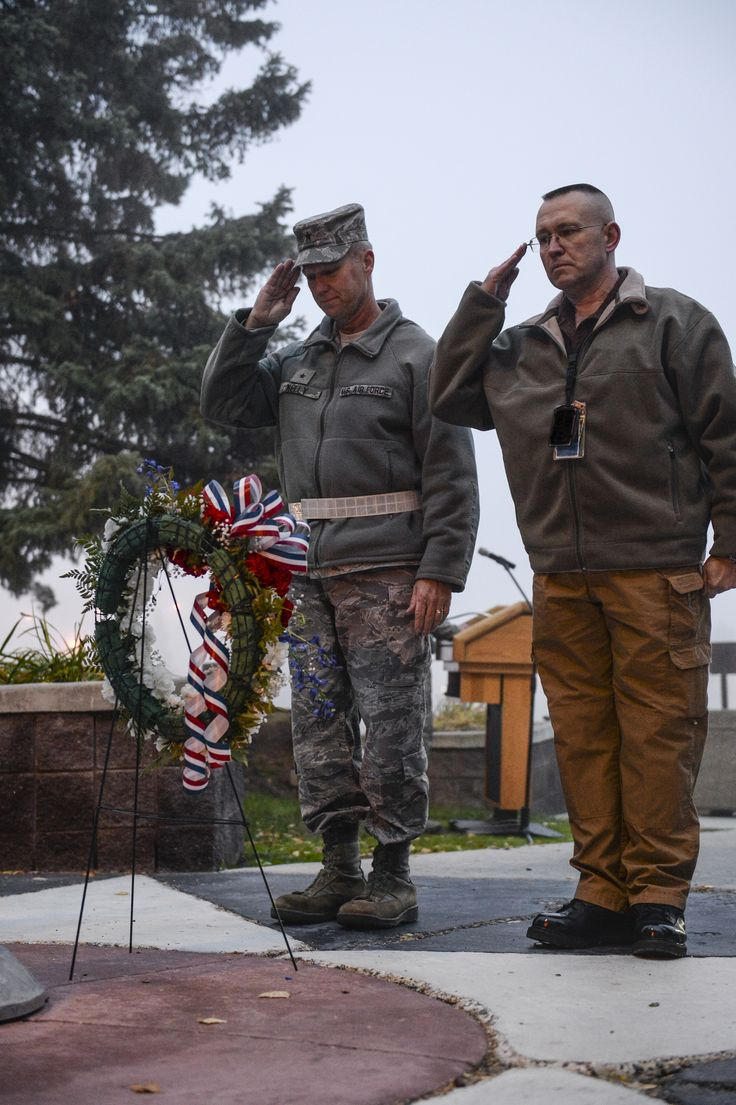 U.S. Air Force Brig. Gen. Mark Kelly, 354th Fighter Wing commander, and Robert Cologie, 354th Operations Support Squadron assistant director of operations, salute a ceremonial wreath during a POW/MIA memorial Sept. 20, 2013, Eielson Air Force Base, Alaksa. The salute marked the end of a 24-hour long POW/MIA flag run in which Icemen took turns carrying the flag, keeping it in constant motion. (U.S. Air Force Photo by Airman 1st Class Peter Reft/Released)