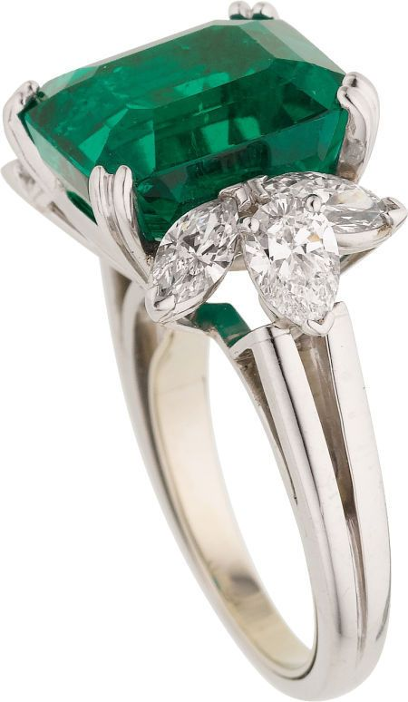 Colombian Emerald, Diamond, Platinum Ring.    Features an emerald-cut emerald weighing 9.95 carats, enhanced by marquise-shaped diamonds weighing a total of approximately 0.80 carat, accented by pear-shaped diamonds weighing a total of approximately 0.75 carat, set in platinum.
