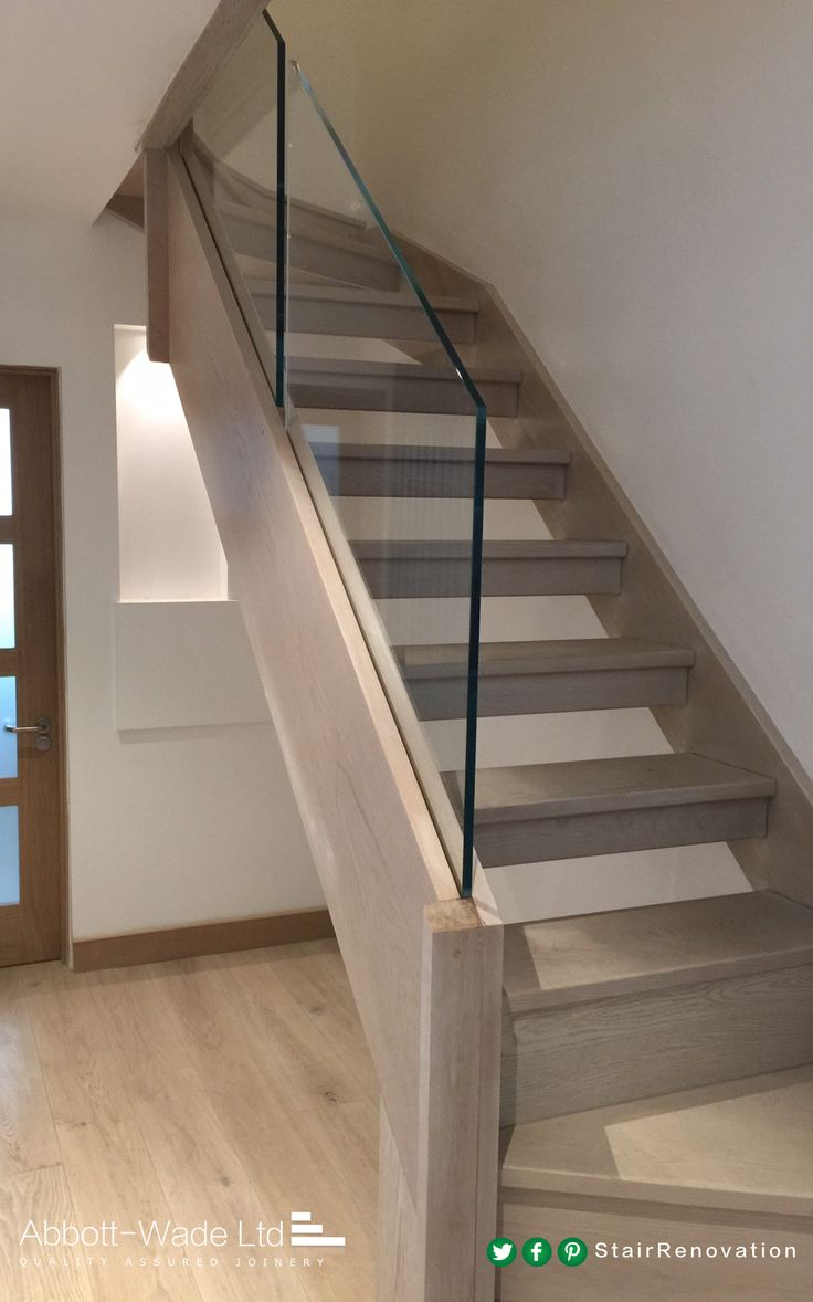 Abbott-Wade open tread, stained oak staircase with frameless glass  balustrade.
