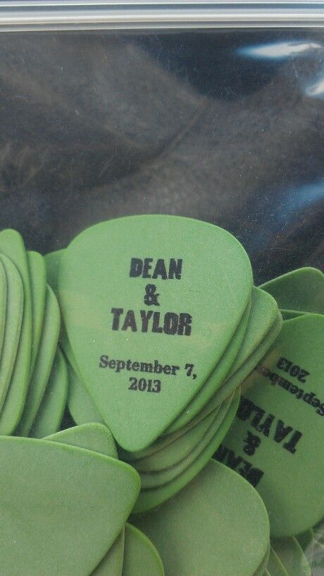 Music theme wedding favors. Guitar picks with our names and date. Ordered online from www.claytoncustom.com :)
